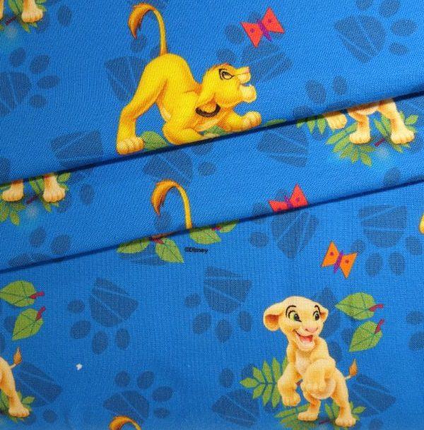 Kids Jerseystoff mittelblau mit Disney Löwen